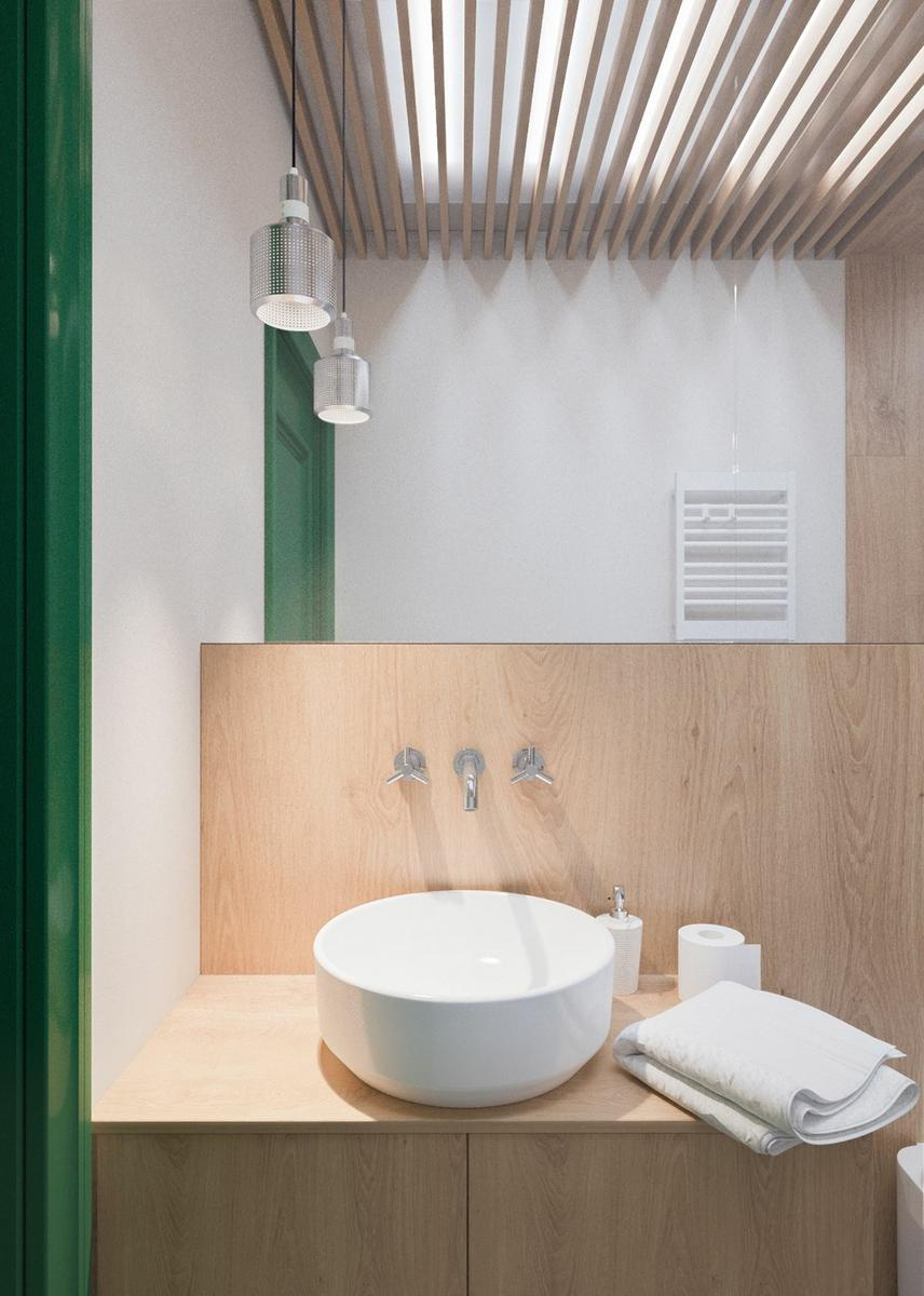 Claves_para_crear_contrastes_de_color_en_la_decoración_espacio_baño_wood-and-green-bathroom-with-skylight-min