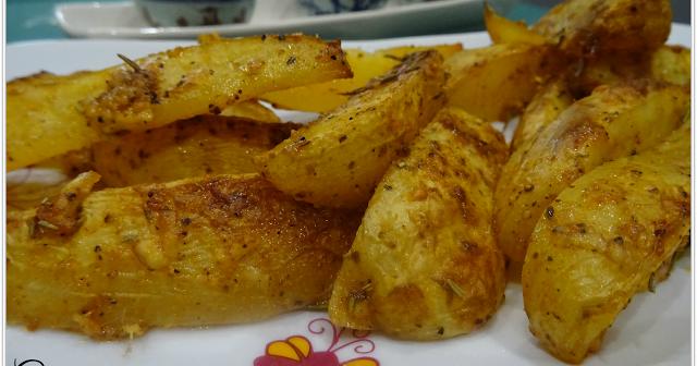 Cuñas de patata al parmesano