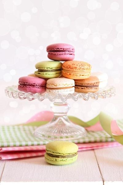French macaroons on cake tray with vintage background
