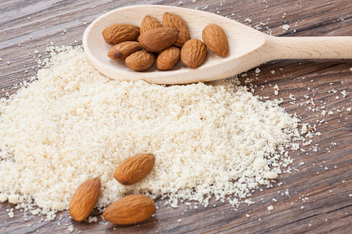 31820730 - almond flour, almonds in a dark wood background