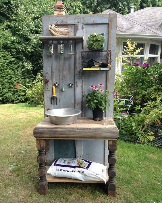 Altered Olives, a British Columbia-based company that creates custom recycled furniture, crafted this one-of-a-kind potting bench from an old wooden door and other salvaged items. - CountryLiving.com: