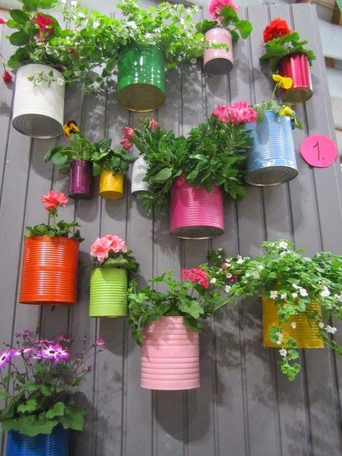 Recycled cans and little bit paint, so colorful and cute! Great idea for a little herb garden! | Outdoor Areas: