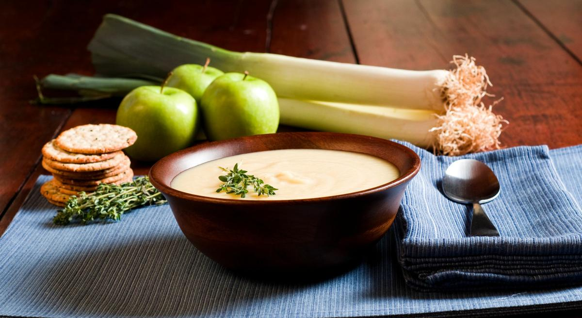 2555401 - apple and leek soup on a rustic table