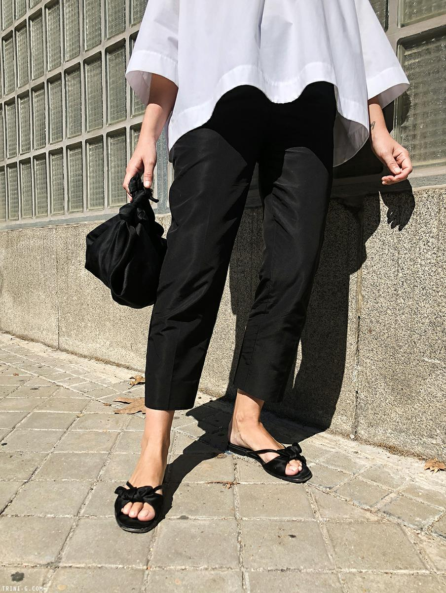 Trini | Balenciaga top Prada trousers