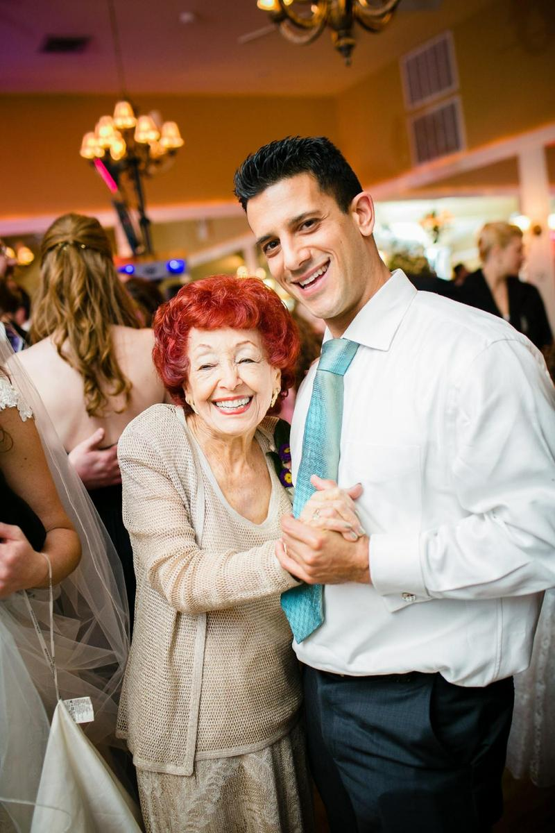 man and grandmother dancing